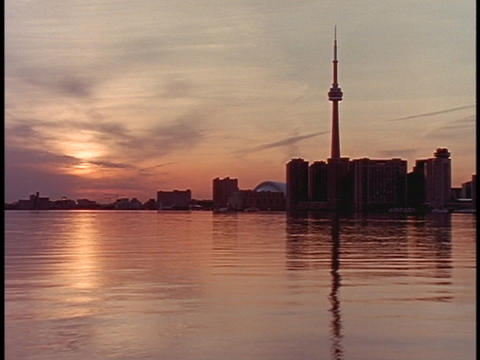 The sun reflects in the water along the shoreline of Toronto Stock Video Footage