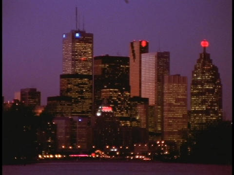 Lights illuminate skyscrapers in Toronto Stock Video Footage