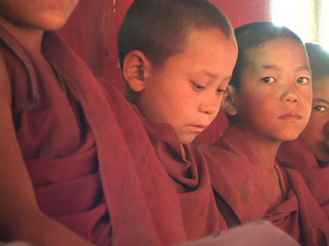 Buddhist boys sit in a row Stock Video Footage