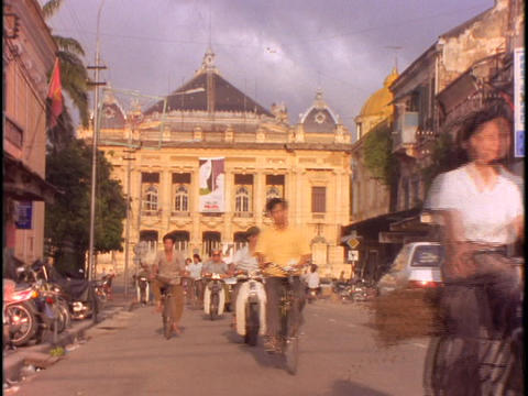 Traffic moves through a busy street in Hanoi Stock Video Footage