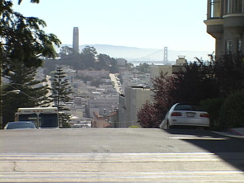Cars sit in front of houses on Nob Hill in San Francisco, California Footage
