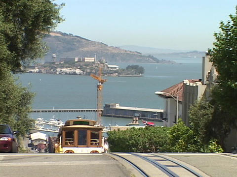 A cable car travels over a hill in San Francisco, California Stock Video Footage