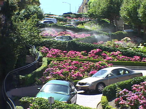 Cars wind down Lombard Street in San Francisco, California Footage