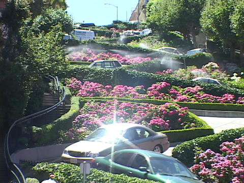 Cars wind down Lombard Street in San Francisco, California Stock Video Footage