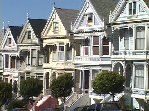 Old Victorian houses line a hill in San Francisco Stock Video Footage