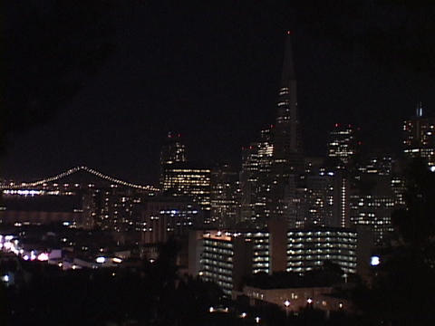 Lights glow on the San Francisco skyline Stock Video Footage