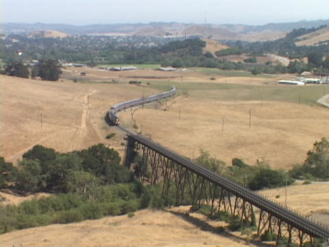 The Amtrak passenger train crosses a bridge Footage