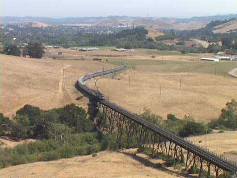 The Amtrak passenger train crosses a bridge Stock Video Footage