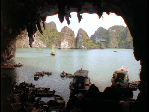 Fishing boats sit in a cave in the South China Sea Footage