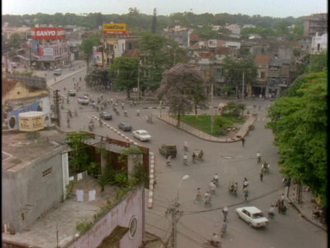 Traffic drives through a neighborhood in Vietnam Stock Video Footage