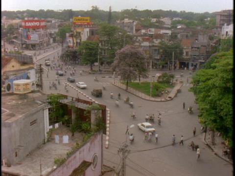 Traffic drives through a neighborhood in Vietnam Stock Video Footage