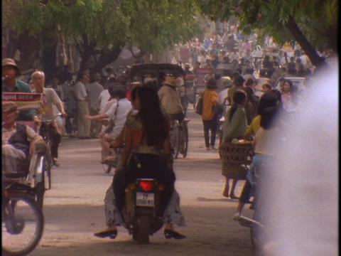 Bikes crowd a street in Hanoi, Vietnam Stock Video Footage