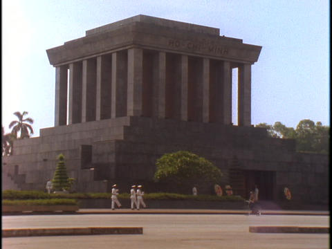 Pedestrians walk outside of the Ho Chi Minh Tomb in... Stock Video Footage