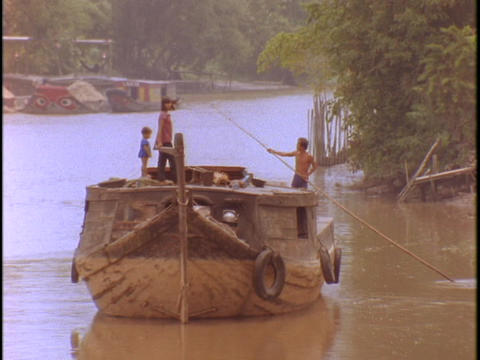 A Vietnamese peasant boat floats on the Mekong River in Vietnam Footage