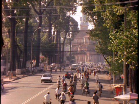 A street in Saigon, Vietnam bustles with traffic and... Stock Video Footage