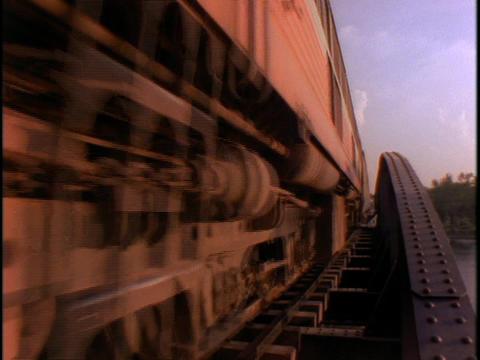 An Asian passenger train crosses a bridge Stock Video Footage