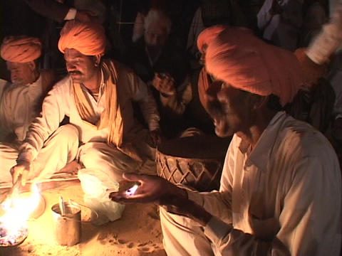 An Indian mystic eats fire at festival in Rajasthan, India Stock Video Footage