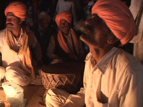 An Indian mystic eats fire at festival in Rajasthan, India Footage