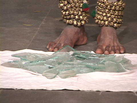 A bare-foot mystic steps on broken glass Stock Video Footage