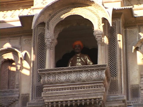 A king stands at the balcony of a palace Stock Video Footage