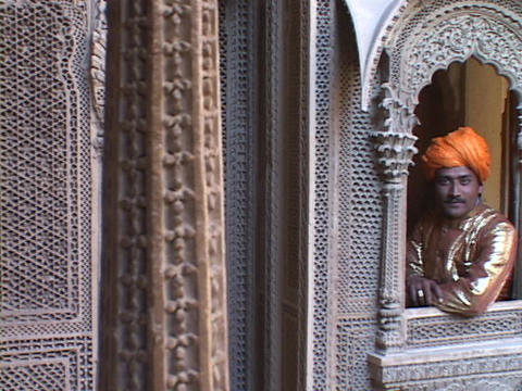 A king leans through the window of a palace balcony Footage