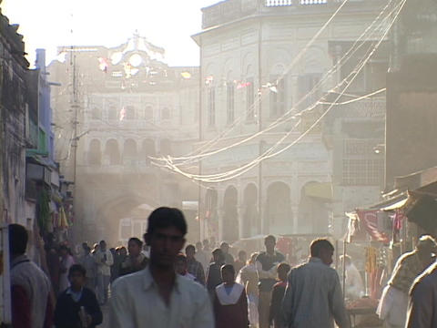 Crowds of people fill a smoky street in India Stock Video Footage