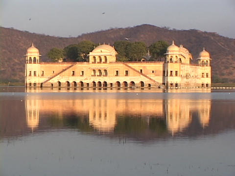 The old maharajah palace reflects in a lake in Rajasthan, India Footage