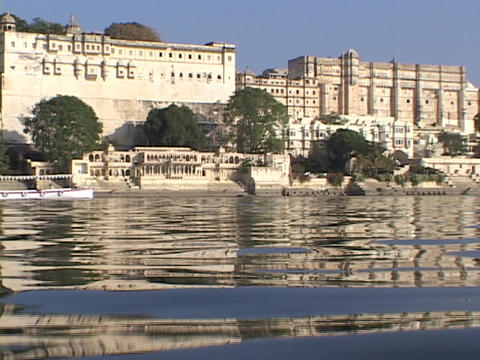 A boat passes by an Indian city Stock Video Footage