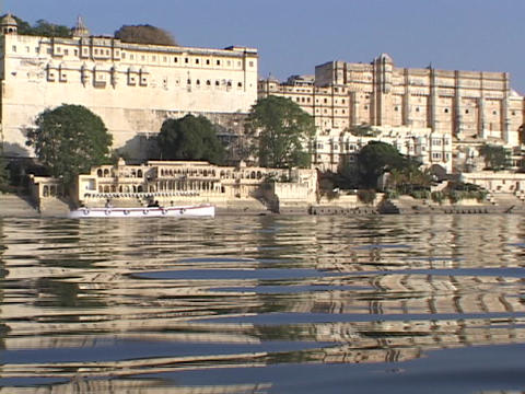 A boat passes by an Indian city Footage