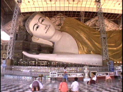 A giant Buddha relines in Burma, Myanmar Stock Video Footage