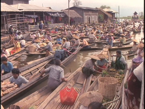 Many boats float in a large market on Inle Lake, Myanmar Stock Video Footage