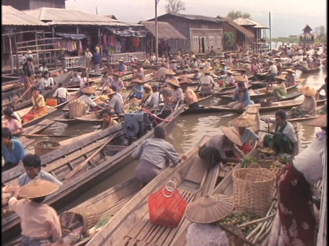 Many boats float in a large market on Inle Lake, Myanmar Footage