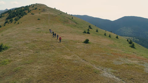 Balkan Mountains/Bulgaria - 27 08 2019: Hiking. Backpackers hiking in mountains Live Action