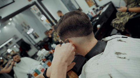 Close-Up Portrait Of Attractive Young Man Getting Trendy Haircut Footage