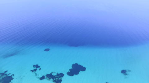 Aerial footage of beautiful turquoise clear sea. Bird view of blue crystal clear sea Live Action