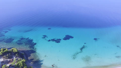 Aerial footage of beautiful turquoise clear sea. Bird view of blue crystal clear sea Footage