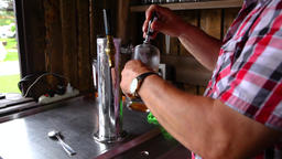 Pouring a draft beer at an outdoor pub Footage