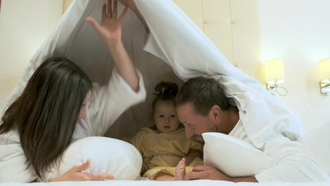 Family having fun in bed Footage