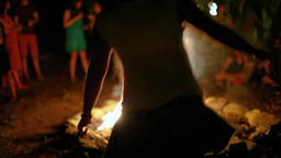 Women dancing around the fire at night Footage