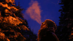 Girl smoking outside in winter, at night in the winter time Footage