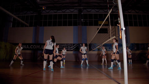Low lighting footage of the professional female volleyball team practicing, 4k Live Action