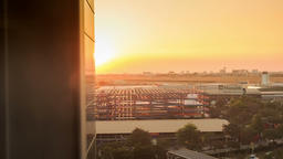 View of Airfield out of Airport Terminal Window at Sunset Footage