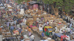 Busy spice market with transport of jute bags,New Delhi,India Footage