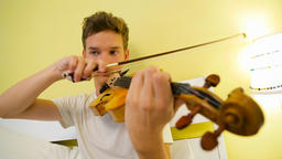 Young Man Playing the Violin Footage