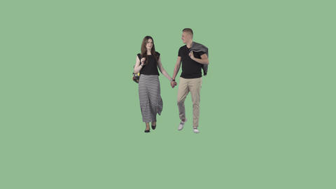 Young male and attractive girl in summer clothes are walking holding hands Footage