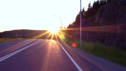 Taking an exit of the highway at sunset Live Action
