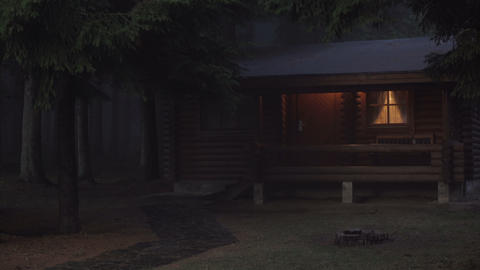 Lonely log cabin with warm glowing windows in the night in spooky,misty, scary ライブ動画