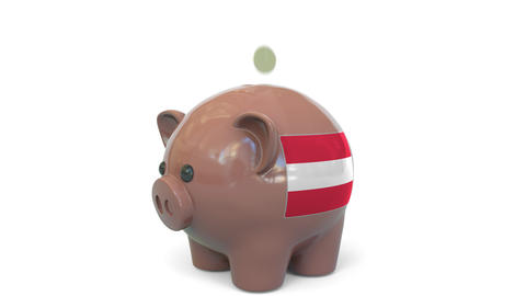 Putting money into piggy bank with flag of Austria. Tax system system or savings Live Action