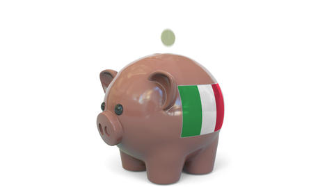 Putting money into piggy bank with flag of Italy. Tax system system or savings Live Action