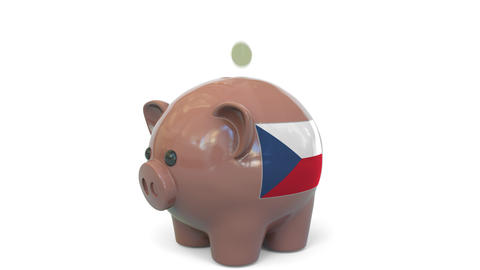 Putting money into piggy bank with flag of the Czech Republic. Tax system system Live Action